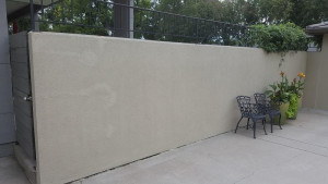 residential painting company stucco wall after