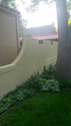 denver house painting stucco wall after